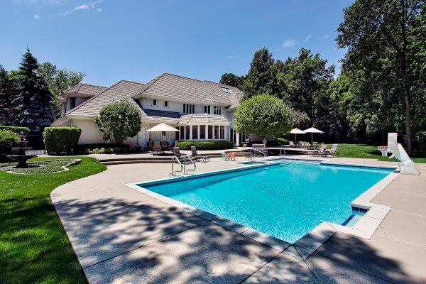 Backyard concrete pool by Scarlet Pools Saint Louis Missouri
