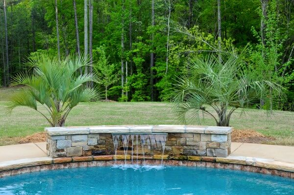 Custom-feature-with-a-waterfall-for-backyard-swimming-pool