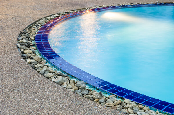 Inground-pool-Finishes-with-blue-tiles-and-pebbles